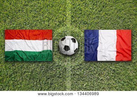 Hungary Vs. France Flags On Soccer Field