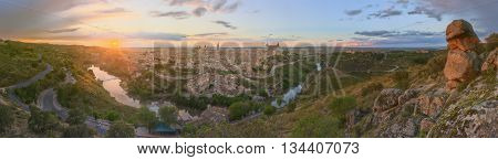 Panoramic view of ancient city and Alcazar on a hill over the Tagus River, Castilla la Mancha, Toledo, Spain.