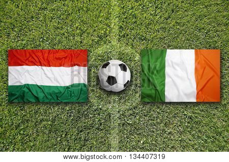 Hungary Vs. Ireland Flags On Soccer Field