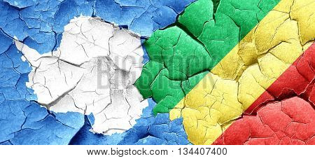 antarctica flag with congo flag on a grunge cracked wall