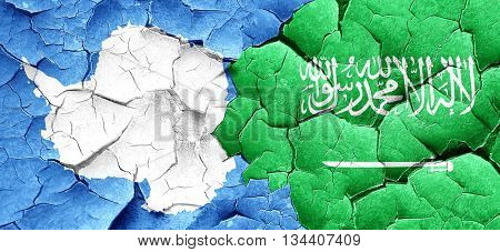 antarctica flag with Saudi Arabia flag on a grunge cracked wall