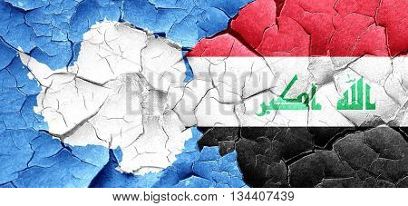 antarctica flag with Iraq flag on a grunge cracked wall