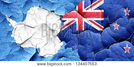 antarctica flag with New Zealand flag on a grunge cracked wall