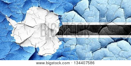 antarctica flag with Botswana flag on a grunge cracked wall