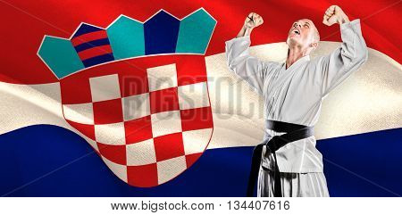 Fighter posing after victory against digitally generated croatia national flag