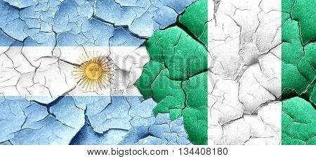 Argentina flag with Nigeria flag on a grunge cracked wall