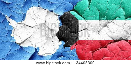 antarctica flag with Kuwait flag on a grunge cracked wall