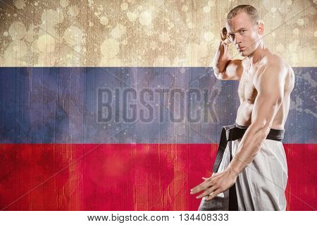 Fighter performing karate stance against russia flag in grunge effect