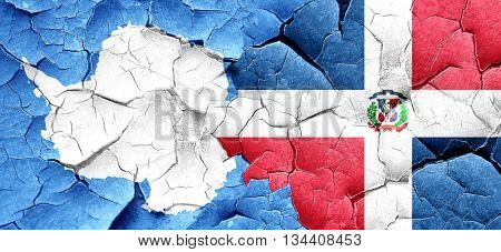 antarctica flag with Dominican Republic flag on a grunge cracked