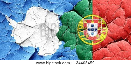 antarctica flag with Portugal flag on a grunge cracked wall