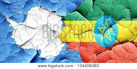 antarctica flag with Ethiopia flag on a grunge cracked wall