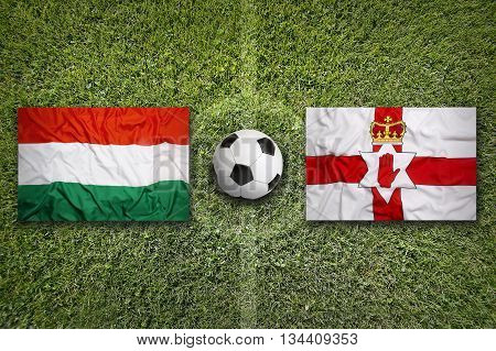 Hungary Vs. Northern Ireland Flags On Soccer Field