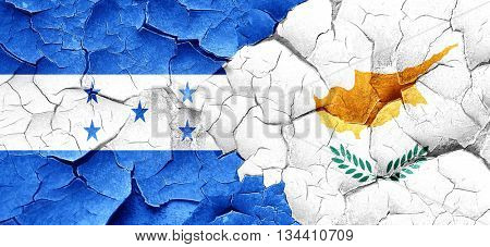 Honduras flag with Cyprus flag on a grunge cracked wall