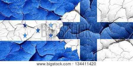 Honduras flag with Finland flag on a grunge cracked wall