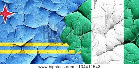 aruba flag with Nigeria flag on a grunge cracked wall