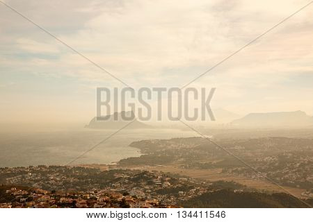 Foggy sunset with aerial Alicante Calpe view from Benitatxell in spain