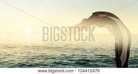 Swimmer in wetsuit while diving against beautiful day in the water
