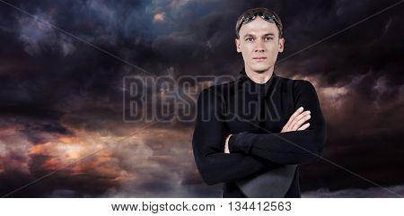Portrait of swimmer in wetsuit against gloomy sky