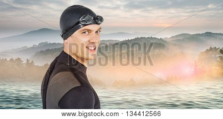 Close-up of confident swimmer in wetsuit against beautiful day in the water