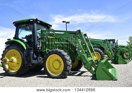 MOORHEAD, MINNESOTA, June 6, 2016: The new tractors with front end loaders are products of John Deere Co, an American corporation that manufactures agricultural, construction, forestry machinery, diesel engines, and drivetrains.