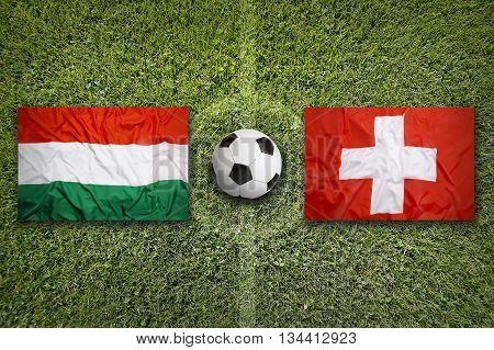 Hungary Vs. Switzerland Flags On Soccer Field