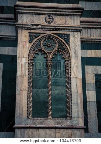 Church window with a lamb symbol in Italy