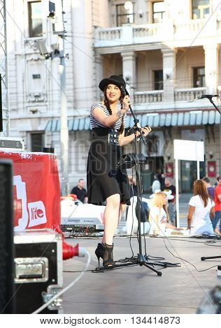BELGRADE,SERBIA-AUGUST 12 ,2011:Zoe,singer of the band Zemlja gruva at the event dedicated to fighting AIDS under the name Dance4life