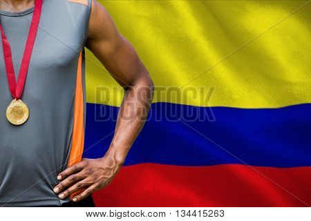 Portrait of sportsman chest with medals against digitally generated colombia national flag