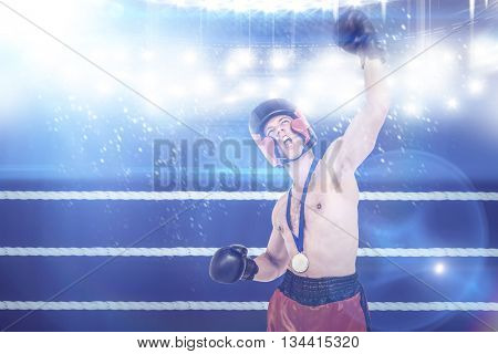 Boxer wearing gold medal performing boxing stance against composite image of ring ropes