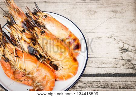 Charcoal grilled river prawns on dish zinc coating vintage style
