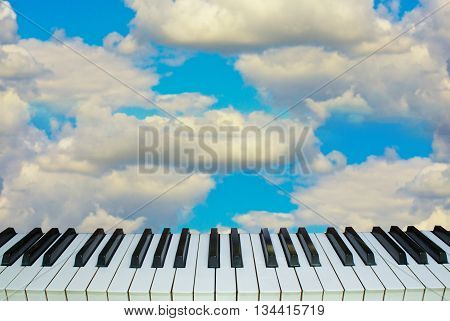 Music and heaven, piano keys against the sky