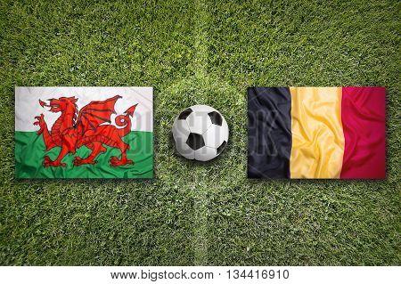 Wales Vs. Belgium Flags On Soccer Field