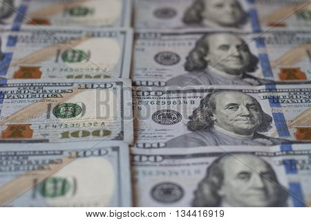 New hundred dollar bills, rows of aligned banknotes closeup