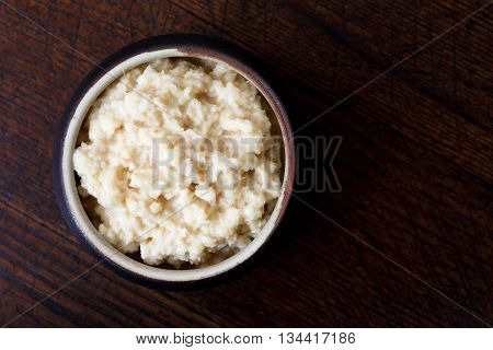 Horseradish Sauce In Rustic Pottery Bowl From Above On Dark Wood. Place For Text.