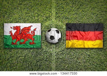 Wales Vs. Germany Flags On Soccer Field