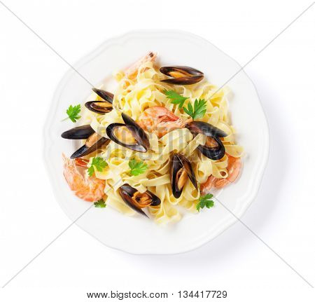 Pasta with seafood. Mussels and prawns. Isolated on white background. Top view