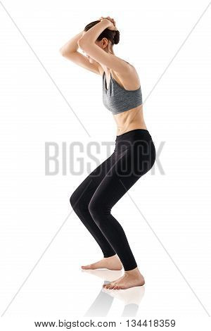 Sporty beautiful young woman practicing Uddiyana Bandha technique isolated on white