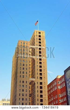 Metropolitan Building With The Us Flag