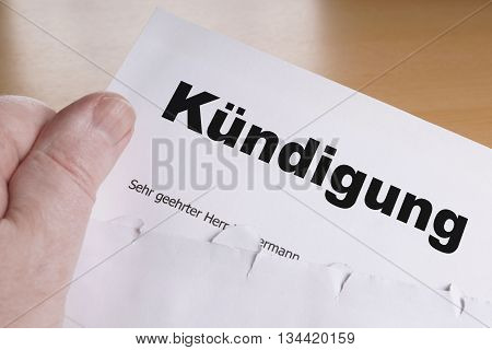 Kuendigung male hand holding german termination letter