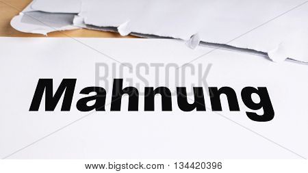 Mahnung german dunning or reminder letter with opened envelope on desk