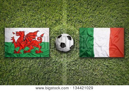 Wales Vs. Italy Flags On Soccer Field