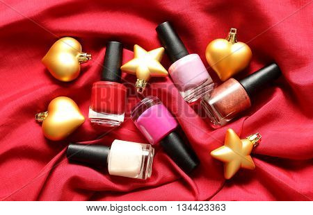 Makeup Christmas or New Year party - nail polish on red silk