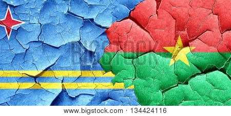 aruba flag with Burkina Faso flag on a grunge cracked wall