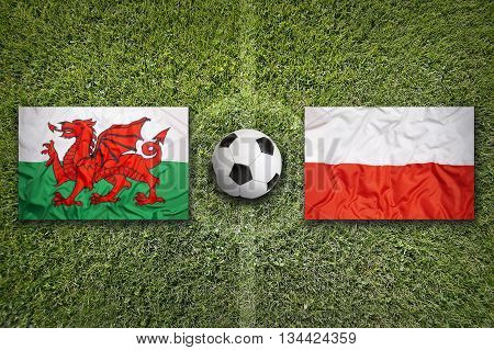 Wales Vs. Poland Flags On Soccer Field