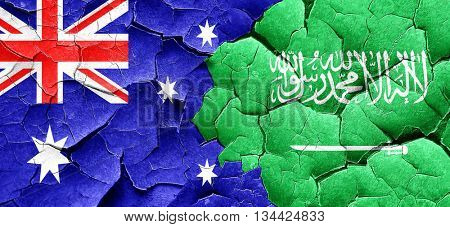 Australia flag with Saudi Arabia flag on a grunge cracked wall