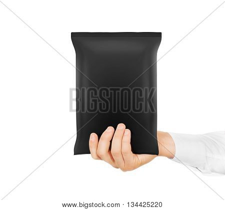 Blank black snack bag mock up hold in hand isolated. Clear grey chips pack mockup. Cookie, candy, sugar, cracker, nuts, supermarket foil frozen plastic container ready for logo design presentation.