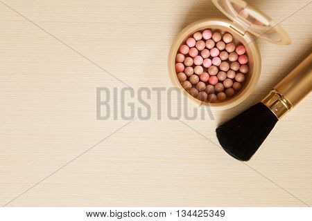 Golden Cosmetics - Powder, Blusher, Brush On Light Wooden Background With Copyspace. Top View, Flat