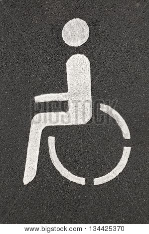 wheelchair pictogram marking handicapped parking space for the disabled