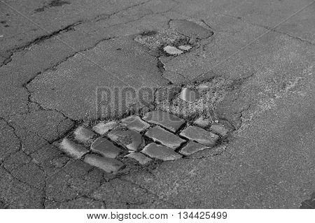 pothole or road damage on city street