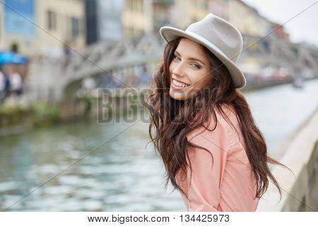 Smiling girl wearing summer shirt at riverside